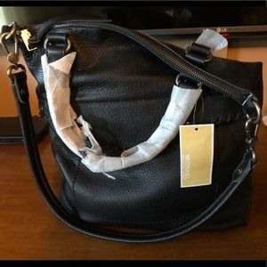 Michael Kors black leather purse. New with tags